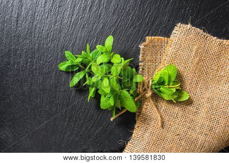 Beautiful Bunch Fresh Green Lemon Mint Tied Twine On Slate And Burlape Background, Close Up