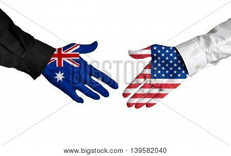 Australia and United States leaders shaking hands on a deal agreement