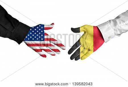 United States and Belgium leaders shaking hands on a deal agreement