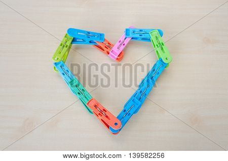 The clothespin heart Love, imagination and arts.