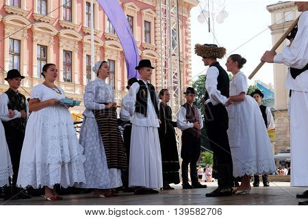 ZAGREB, CROATIA - JULY 23: Members of folk group from Tavankut, Serbia  during the 50th International Folklore Festival in center of Zagreb, Croatia on July 23, 2016