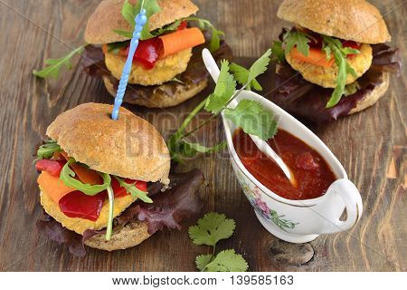 Vegetarian bean burgers with vegetables served with sauce