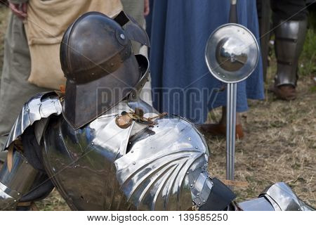 Tewkesbury, UK-July 17, 2015: Knight in armour from rear on 17 July 2015 at Tewkesbury Medieval Festival