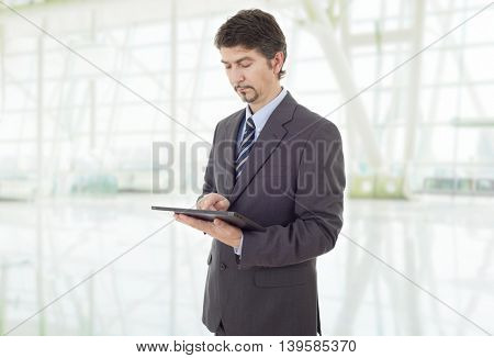 businessman thinking with a tablet pc, at the office