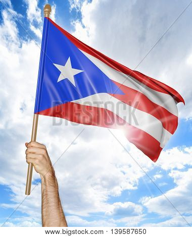 Person's hand holding the Puerto Rican national flag and waving it in the sky, 3D rendering