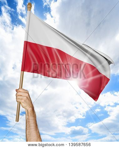 Person's hand holding the Polish national flag and waving it in the sky, 3D rendering