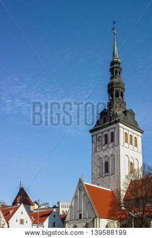 Niguliste or St. Nicholas Church and tile roofs in Tallinn