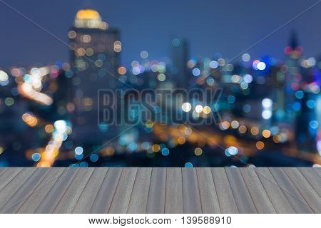 Opening wooden floor, Abstract blurred bokeh lights city downtown background
