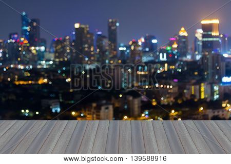 Opening wooden floor, Night blurred lights, Business building downtown