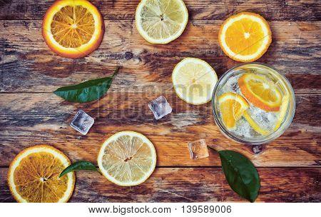 orange lemon leaves glass homemade lemonade ice on old wooden table top view rustic style