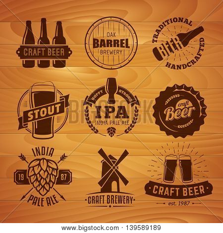 Set of vector craft beer logos and badges. Retro beer labels on vintage wooden background