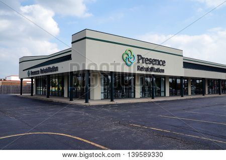 JOLIET, ILLINOIS / UNITED STATES - AUGUST 30, 2015: Presence Rehabilitation offers outpatient physical therapy, in a Shorewood strip mall.