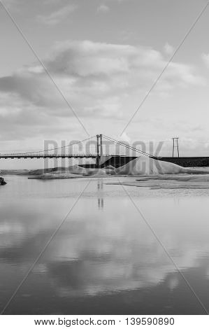 Black and White, Suspension bridge over Jakulsarlon lagoon with reflection view, Iceland