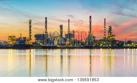 Heavy industrial oil refinery riverfront with beautiful sunrise sky background