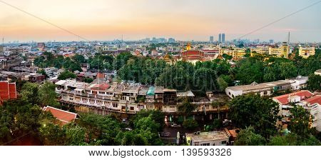 Panorama view of Bangkok from Golden Mountain on sunset cloudy sky Thailand. Traditional architecture of Bangkok from the height of bird flight.