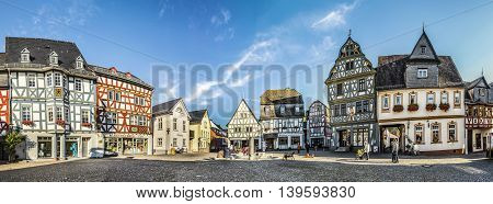 People Enjoy Historic Market Place In Bad Camberg.