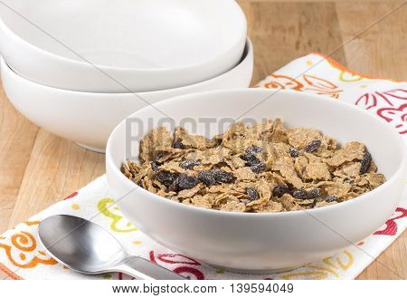 a bowl of healthy bran cereal with raisins