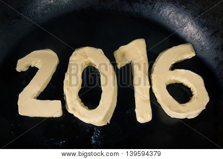 Butter In Shape Of Number 2016 On Hot Pan - Close Up Top View