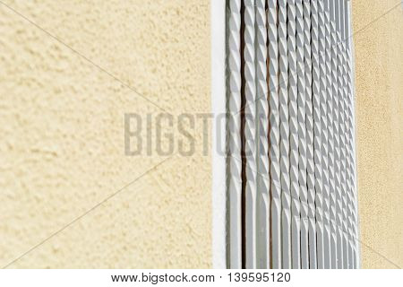 Old style of vintage white grille on the window perspective background