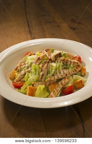 Grilled chicken salad with lettuce and tomatoes