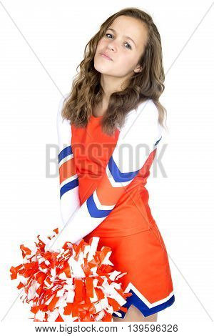Pretty Teen Cheerleader Standing Holding Orange And White Pom-poms Arms Crossed