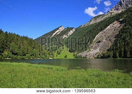 Landscape in Glarus Canton Swiss Alps. Lake Obersee.