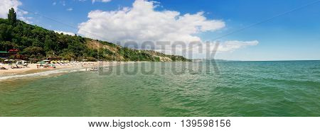 Summer vacation background at the seashore beach. Panoramic view of the coast of Black Sea Balchik city Bulgaria
