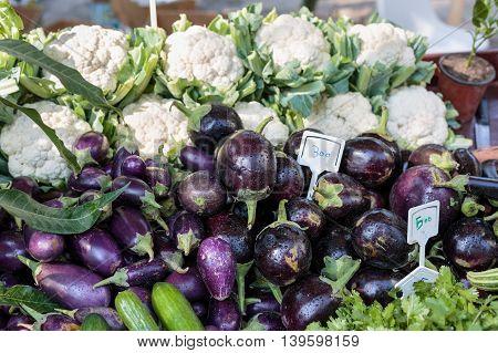 BUDAIYA, BAHRAIN - DECEMBER 27, 2014: Locally grown and Fresh Aubergine along with other vegetables for sale in Bahrain Farmers Market in Budaiya Botanical Garden.