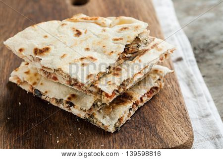 Pile Of Quesadillas With Chicken And Vegetables On The Rustic Board