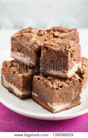 Marble Chocolate Brownies With Mascarpone Are Stacked On A Plate