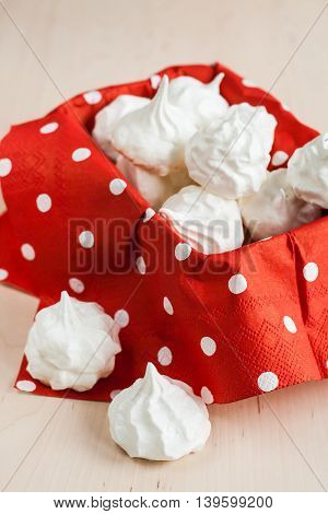 Small Meringues Meringue On A Red Background