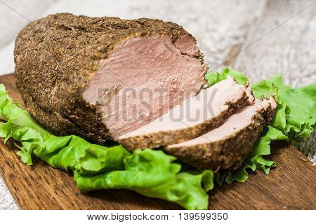 Cold Boiled Pork In A Cut With Salad Leaves