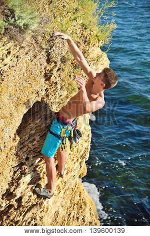 Climber Hanging By A Cliff