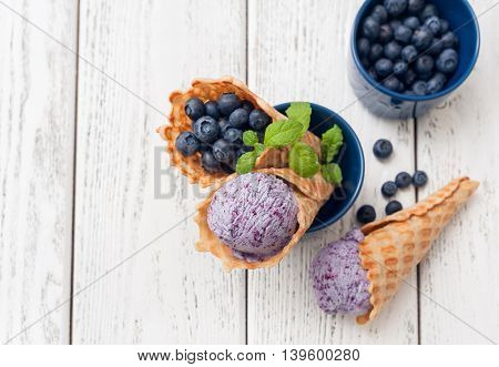 Homemade blueberry ice cream in waffle cones