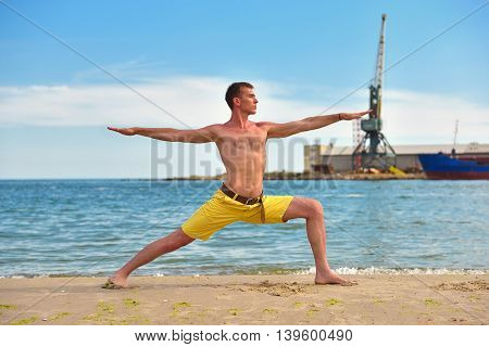 Man Making Yoga Exercises