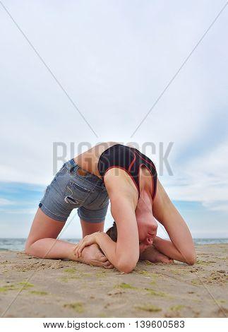 Girl Doing Yoga On Coast