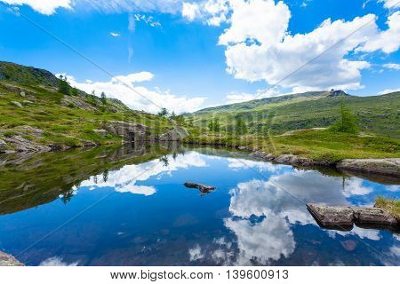 Italian Mountain Panorama, Clouds Reflected On Alpine Lake