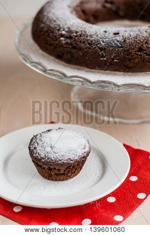 chocolate cupcake muffin with powdered a sugar.