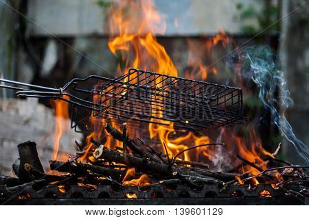 fire in the grill on the street.