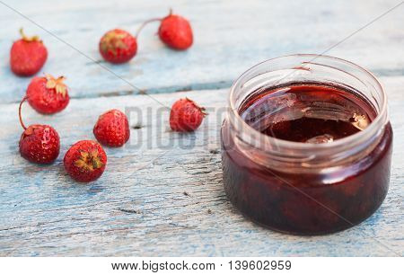 Liquid Strawberry Jam In A Jar With A Spoon