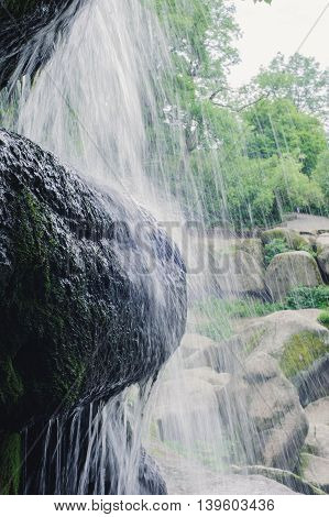 Beautiful Waterfall with jets of water on the rocks. Landscape. Trevel to waterfall.