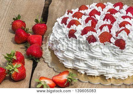 Light, delicate and tasty cream cake with fresh strawberries (half cake)
