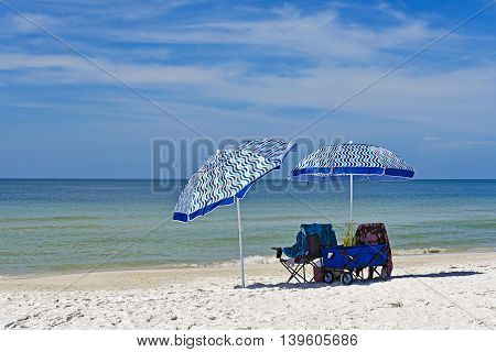 Beach Chairs with Umbrellas and a Wagon on the Beach