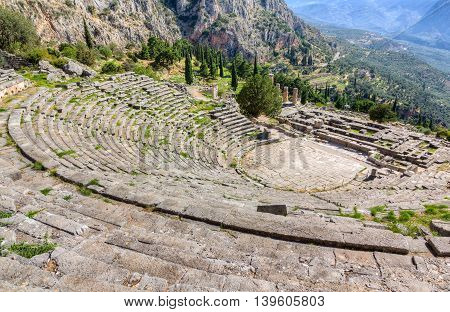 View of ancient Delphi theater and Apollo temple, Greece