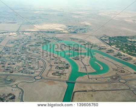 aerial view of Qatar with artifical water canals in the desert