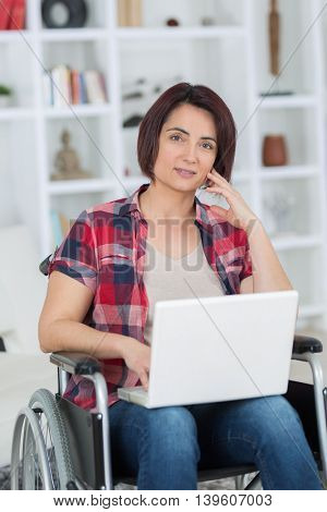 disabled handicapped girl with laptop computer