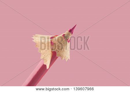 Front view of pink pencil with wooden shaving on top