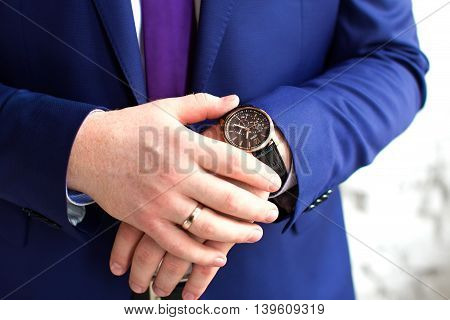 Man hands push button of old round stopwatch. Close up