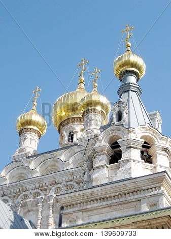 Gold Domes of white stone Russian orthodox Church St. Maria Magdalena in Jerusalem Israel
