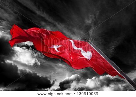 Flag Of Turkey Waving Against Black And White Sky